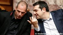 18.02.2015 *** Greek Prime Minister Alexis Tsipras (R) and Finance Minister Yanis Varoufakis talk during the first round of a presidential vote at the Greek parliament in Athens February 18, 2015. Tsipras secured enough parliamentary votes on Wednesday for his nominee, former interior minister Prokopis Pavlopoulos, to become the country's next president. REUTERS/Alkis Konstantinidis (GREECE - Tags: POLITICS ELECTIONS BUSINESS)