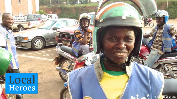Portrait of Claudine wearing a motorcycle helmet. Photo: Jesko Johannsen
