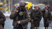04.03.2015 * Miners walk out of the Zasyadko coal mine in Donetsk March 4, 2015. Dozens of miners were trapped underground and feared dead after a blast on Wednesday at the coal mine in the eastern Ukrainian rebel stronghold of Donetsk. Mine officials said the explosion was most likely caused by gas and not linked to fighting at the nearby frontline in the war between Moscow-backed rebels and Ukraine government forces. The regional administration said the bodies of nine miners have been found so far but the fate of another 23 remains unknown. REUTERS/Baz Ratner (UKRAINE - Tags: POLITICS CONFLICT CIVIL UNREST ENERGY DISASTER)
