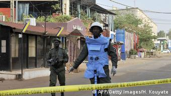 Policeman blocks access to the scene of an attack at a restaurant in Bamako. Photo: HABIBOU KOUYATE/AFP/Getty Images