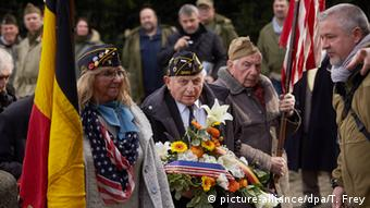 US World War Two veterans with flags