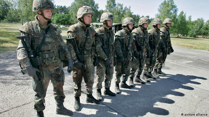 Bundeswehr soldiers lined up in combat gear