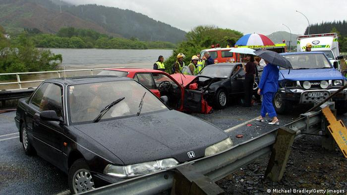 Car accident in New Zealand with water in background. (Photo by Michael Bradley/Getty Images)