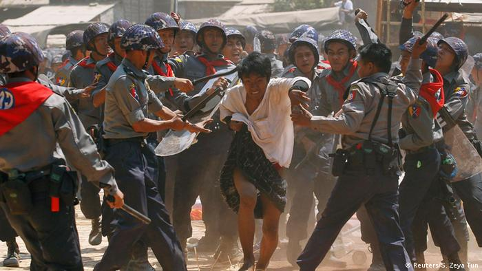 Myanmar police beat student protester