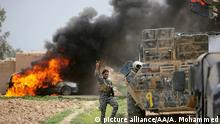 09.03.2015 * TIKRIT, IRAQ - MARCH 09: A member of Iraqi forces flashes V sign near a tank during clashes between Iraqi army forces, supported by Shiite militias, and Daesh (Islamic State of Iraq and the Levant) in Tikrit, Iraq on March 09, 2015. Ali Mohammed / Anadolu Agency