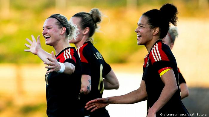 German players of the Women's National Soccer Team celebrate a goal. (Photo: EPA/JOSE SENA GOULAO)