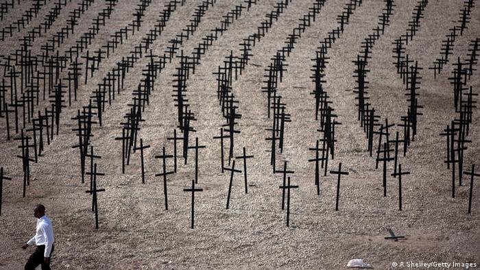 Crosses set up as a memorial to the people killed in the Haiti earthquake (A.Shelley/Getty Images)