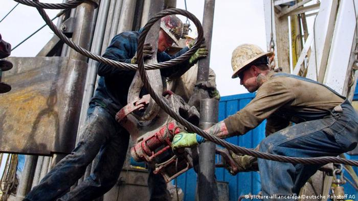 Two oil drillers drill for oil
