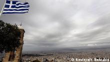 06.03.2015 * A Greek flag flutters atop the Lycabetus hill overlooking Athens March 6, 2015. Greece's central bank chief Yannis Stournaras said on Friday that the country's banks are sufficiently recapitalised and face no problem with deposit outflows. REUTERS/Yannis Behrakis (GREECE - Tags: POLITICS BUSINESS SOCIETY)