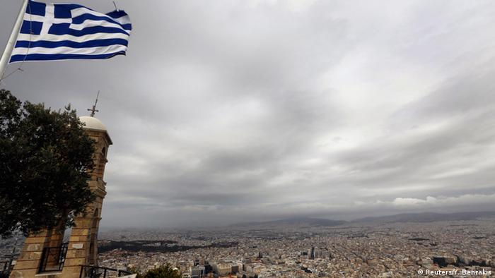 A cliff bearing a Greek flag, overlooking Athens