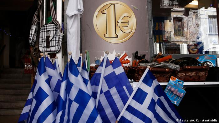 Greek national flags are displayed for sale at the entrance of a one Euro shop in Athens, March 2, 2015.