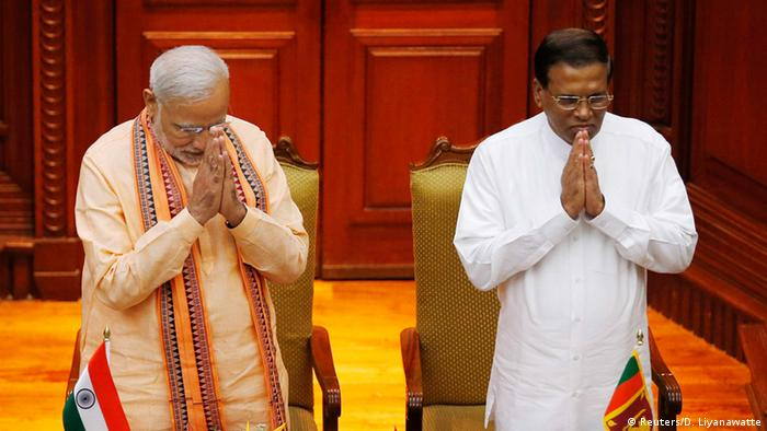 India's Prime Minister Narendra Modi gestures with Sri Lanka's President Maithripala Sirisena in Colombo March 13, 2015.