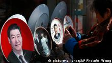 04.03.2015 ****In this Wednesday, March 4, 2015 photo, a woman takes picture of the souvenir plates bearing an image of Chinese President Xi Jinping and his wife Peng Liyuan, on display for sale at a shop near Tiananmen Square in Beijing. Barely two years into office, Xi has attracted an extraordinary degree of attention to his public persona that veers perilously close to a full-blown personality cult. Such a phenomenon has not seen since the days of Mao Zedong, with successors wary of the turmoil his leadership unleashed and generally favoring a dry, rule-by-consensus approach. (AP Photo/Andy Wong)