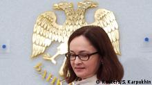 Russia's Central Bank Governor Elvira Nabiullina arrives at a news conference after the bank's second monetary policy meeting of the year in Moscow March 13, 2015. The Russian central bank cut its main lending rate on Friday, for the second time this year, putting concerns about the declining economy before worries about high inflation. REUTERS/Sergei Karpukhin (RUSSIA - Tags: BUSINESS)