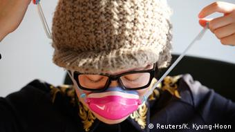 Chinese woman donning a face mask. Photo REUTERS/Kim Kyung-Hoon