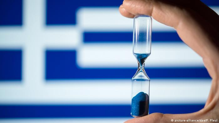 Hour glass and Greek flag