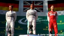 MELBOURNE, AUSTRALIA - MARCH 15: Lewis Hamilton of Great Britain and Mercedes GP stands on the podium with Nico Rosberg of Germany and Mercedes GP and Sebastian Vettel of Germany and Ferrari after winning the Australian Formula One Grand Prix at Albert Park on March 15, 2015 in Melbourne, Australia. (Photo by Dan Istitene/Getty Images)