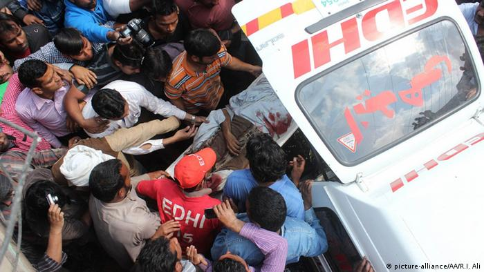 Victim of bombing being put into ambulance. Rana Irfan Ali / Anadolu Agency
