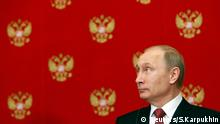 05.03.2015 Russian President Vladimir Putin attends a news conference following a meeting with Italian Prime Minister Matteo Renzi at the Kremlin in Moscow, March 5, 2015. REUTERS/Sergei Karpukhin (RUSSIA - Tags: POLITICS)