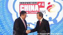 16.03.2015 * German Vice Chancellor Sigmar Gabriel shakes hands with China's Vice Premier Ma Kai (R) prior to touring the CeBIT trade fair in Hanover March 16, 2015. The world's biggest computer and software fair will open to the public from March 16 to 20. REUTERS/Morris Mac Matzen (GERMANY - Tags: BUSINESS SCIENCE TECHNOLOGY POLITICS)