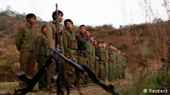 Kokang rebels lined up REUTERS/Stringer