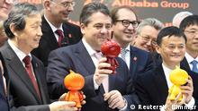 16.03.2015 * China's Vice Premier Ma Kai, German Vice Chancellor and Economy Minister Sigmar Gabriel, German Traffic and Digital Infrastructure Minister Alexander Dobrindt and Alibaba founder and CEO Jack Ma (L-R) hold figures that were presented to them while touring the CeBIT trade fair in Hanover March 16, 2015. The world's biggest computer and software fair will open to the public from March 16 to 20. REUTERS/Fabian Bimmer (GERMANY - Tags: BUSINESS SCIENCE TECHNOLOGY POLITICS)