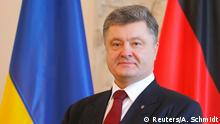 16.03.2015 * Ukrainian President Petro Poroshenko poses for the media during a welcoming ceremony at Bellevue presidential palace in Berlin March 16, 2015. REUTERS/Axel Schmidt (GERMANY - Tags: POLITICS HEADSHOT)