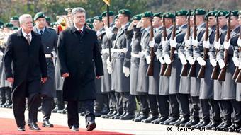 Earlier on Monday, Poroshenko was welcomed to Berlin by German President Joachim Gauck