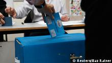 An Israeli casts his ballot for the parliamentary election at a polling station in Tel Aviv March 17, 2015. Prime Minister Benjamin Netanyahu's march towards becoming the longest-serving leader of Israel could be halted on Tuesday in an election that has exposed public fatigue with his stress on national security rather than socio-economic problems. REUTERS/Baz Ratner (ISRAEL - Tags: POLITICS ELECTIONS)