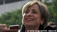 March 16, 2015 Mexican journalist Carmen Aristegui speaks to the press in Mexico City on March 16, 2015 a day after being fired. Aristegui, an influential Mexican broadcast journalist whose report about the first lady's mansion caused a scandal was sacked Sunday, sparking anger among supporters who called her firing an affront to freedom of speech. Aristegui had been publicly feuding with her employer, MVS Radio, in recent days after two of her investigative reporters were fired by the company. AFP PHOTO / RONALDO SCHEMIDT (Photo credit should read RONALDO SCHEMIDT/AFP/Getty Images)