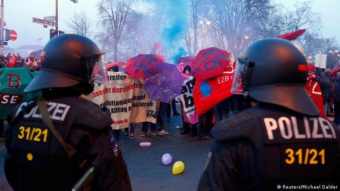 Anti-capitalist 'Blockupy' protesters stand in front of a police cordon near the European Central Bank (ECB) building before the official opening of its new headquarters in Frankfurt March 18, 2015