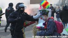 Riot police clash with protesters dressed as clowns on the opening day of the European Central Bank (ECB) in Frankfurt am Main, western Germany, on March 18, 2015. Supporters of the so-called Blockupy alliance consisting of social movements, activists, workers, trade unions and parties are expected to stage large protests against austerity and the authority of the European Central Bank when the bank's new headquarters officially will be on March 18, 2015. AFP PHOTO / DANIEL ROLAND (Photo credit should read DANIEL ROLAND/AFP/Getty Images)