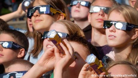 people wearing eclipse glasses