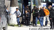 Tourists and visitors from the Bardo museum are evacuated in Tunis, Wednesday, March 18, 2015 in Tunis, Tunisia. Gunmen opened fire at a leading museum in Tunisia's capital, killing 19 people including 17 tourists, the Tunisian Prime Minister said. A later raid by security forces left two gunmen and one security officer dead but ended the standoff, Tunisian authorities said. (AP Photo/Hassene Dridi)