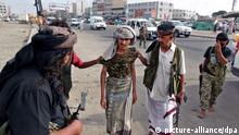 19.03.2015 * epa04669414 Members of a southern tribal militia loyal to Yemeni President Abdo Rabbo Mansour Hadi arrest a man (C) believed to be a Yemeni soldier during clashes in the southern port city of Aden, Yemen, 19 March 2015. According to reports deadly clashes broke out between southern tribal militias loyal to Yemeni President Hadi and security forces in Aden allegedly loyal to former President Ali Abdullah Saleh, killing at least seven people and forcing the closure of Aden's international airport. EPA/STR