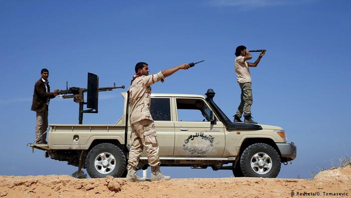 Libya Dawn fighters look at Islamic State (IS) militant positions near Sirte