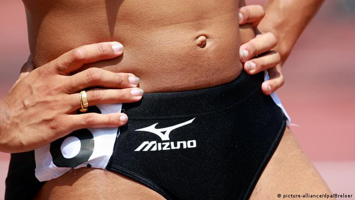 Athlete with belly button on show