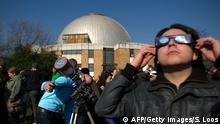 20.03.2015** People use protective glasses and filters on telescopes as they gather in front of a planetarium in Berlin to catch a glimpse of a solar eclipse on March 20, 2015. A partial eclipse of varying degrees is visible, depending on weather conditions, across most of Europe, northern Africa, northwest Asia and the Middle East, before finishing its show close to the North Pole. AFP PHOTO / STEFFI LOOS (Photo credit should read STEFFI LOOS/AFP/Getty Images)