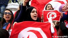 Tunisian protesters shout slogans as they wave banners and their national flag during a demonstration on Bourguiba Avenue, capital of Tunis, March 20, 2015, during Independence Day celebrations marking the 58th anniversary of independence in Tunis. REUTERS/Anis Mili (TUNISIA - Tags: CRIME LAW CIVIL UNREST POLITICS)