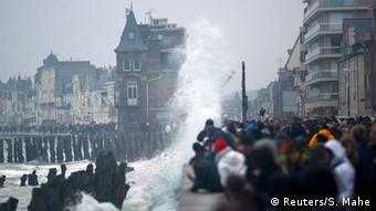Wave surging over an embankment in St. Malo