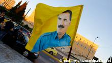 A flag with the picture of imprisoned PKK (Kurdistan Workers' Party) leader Abdullah Öcalan flies at the protest. Kurds living in Greece marched to the European Union (EU) offices in Athens to protest against attacks by Islamic State (IS) fighters on the city of Kobane in Syria. Their anger was mostly directed towards Turkey, and the inactivity of the Turkish Army to come to the aid of the besieged city. (Photo by Michael Debets / Pacific Press)