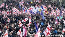 epa04673429 Supporters the Georgia's opposition party 'National Movement' march during a protest rally in Tbilisi, Georgia, 21 March 2015. The Georgian opposition party 'National Movement', of which the former Georgian president Mikheil Saakashvili is the leader, demands resignation of Georgia's government. EPA/ZURAB KURTSIKIDZE / eingestellt von: ml