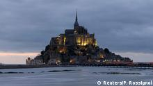 The incoming high tide surrounds the Mont Saint-Michel 11th century abbey off France's Normandy coast