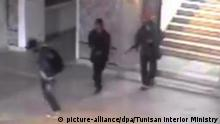epa04674036 A handout photograph made available by the Tunsian Interior Ministry on 22 March 2015 showing gunmen walking through the Bardo museum, in Tunis, Tunisia on 18 March 2015 during the attack that killed 25 people including 20 foreign tourists. The attack, where gunmen stormed the Bardo Museum, claimed by the Islamic State extremist group, was Tunisia's deadliest in more than a decade. EPA/TUNISAN INTERIOR MINISTRY / HANDOUT HANDOUT EDITORIAL USE ONLY/NO SALES