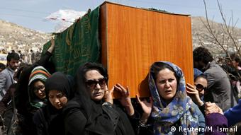 Afghan women's rights activists carry the coffin of Farkhunda, an Afghan woman who was beaten to death and set alight on fire on Thursday, during her funeral ceremony in Kabul March 22, 2015 (Photo: REUTERS/Mohammad Ismail)