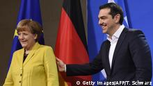 Bildunterschrift:German Chancellor Angela Merkel (L) and Greek Prime Minister Alexis Tsipras leave after addressing a press conference following talks at the chancellery in Berlin, on March 23, 2015. AFP PHOTO / TOBIAS SCHWARZ (Photo credit should read TOBIAS SCHWARZ/AFP/Getty Images)