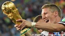 13.7.2014 *** FILE - Bastian Schweinsteiger of Germany celebrates with the trophy after winning the FIFA World Cup 2014 final soccer match between Germany and Argentina at the Estadio do Maracana in Rio de Janeiro, Brazil, 13 July 2014. Photo: Andreas Gebert/dpa (RESTRICTIONS APPLY: Editorial Use Only, not used in association with any commercial entity - Images must not be used in any form of alert service or push service of any kind including via mobile alert services, downloads to mobile devices or MMS messaging - Images must appear as cstill images and must not emulate match action video footage - No alteration is made to, and no text or image is superimposed over, any published image which: (a) intentionally obscures or removes a sponsor identification image; or (b) adds or overlays the commercial identification of any third party which is not officially associated with the FIFA World Cup) EDITORIAL USE ONLY (zu dpa-Meldung: «Schweinsteiger vor emotionaler Kapitäns-Premiere - Löw: Brauchen ihn» vom 24.03.2015) +++(c) dpa - Bildfunk+++