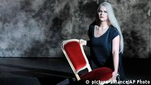 FILE - In this March 22, 2010 file photo singer Maria Radner as first norn performs during a dress rehearsal for Richard Wagner's opera Goetterdaemmerung which is part of the Salzburg Easter Festival in Salzburg, Austria. A Spanish opera house said Tuesday, March 24, 2015 German contralto Maria Radner along with her husband and baby, were among the 150 victims of the Germanwings plane crash in the French Alps. (AP Photo/Kerstin Joensson, file)