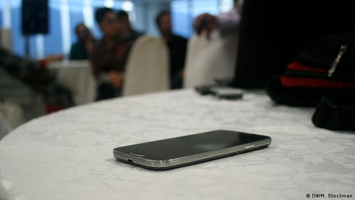 A mobile phone lays on a table