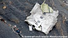 25.03.2015 A photo released March 25, 2015 by the French Interior Ministry shows a rescue worker near a fuselage section amongst the debris at the crash site of an Airbus A320, near Seyne-les-Alpes. French investigators will sift through wreckage on Wednesday for clues into why a German Airbus operated by Lufthansa's Germanwings budget airline plowed into an Alpine mountainside, killing all 150 people on board including 16 schoolchildren returning from an exchange trip to Spain. REUTERS/French Interior Ministry/Handout TPX IMAGES OF THE DAY FOR EDITORIAL USE ONLY. NOT FOR SALE FOR MARKETING OR ADVERTISING CAMPAIGNS.